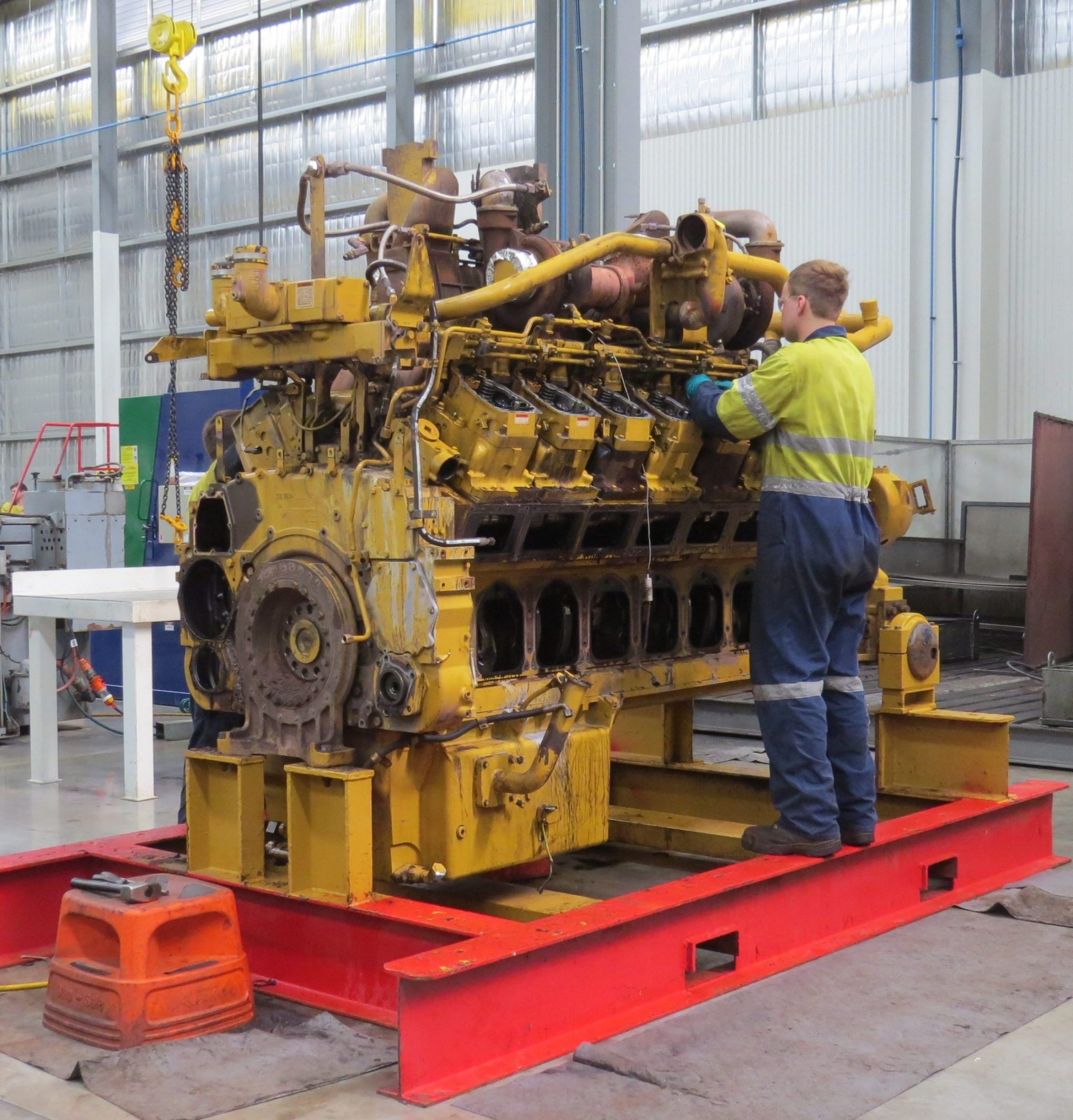 Cavpower employee repairing engine at Cavpower's Component Rebuild Centre